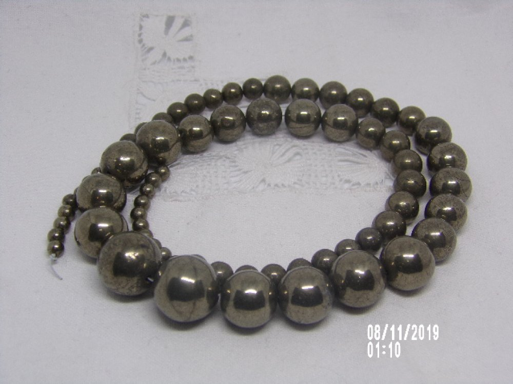Fil de 68 perles de Pyrite graduée ronde