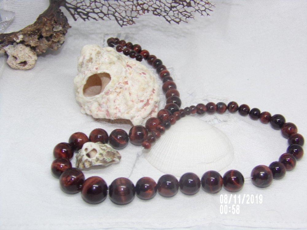 Fil de 51 perles œil de taureau  naturelles, graduée ronde