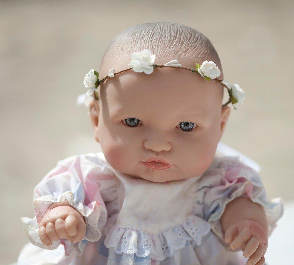 Couronne de fleurs pour bébé, poupon ou nounours