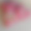 Coussin de porte rouge et sa fraise brodée au point de croix