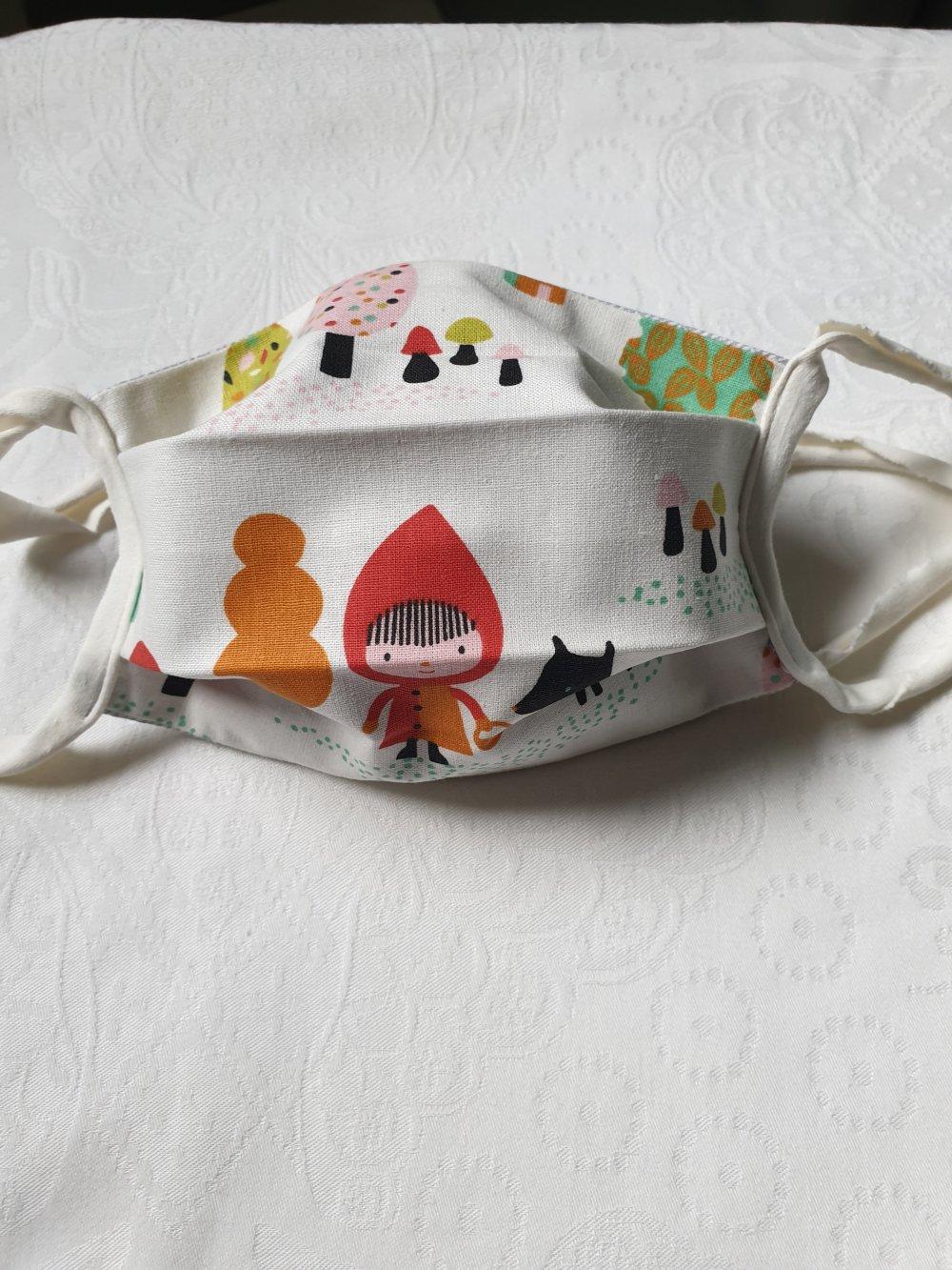 Masques de protection enfant de 3 à 9 ans en tissu imprimés et lien lycra lavables . Fabriqués selon les recommandations  AFNOR.