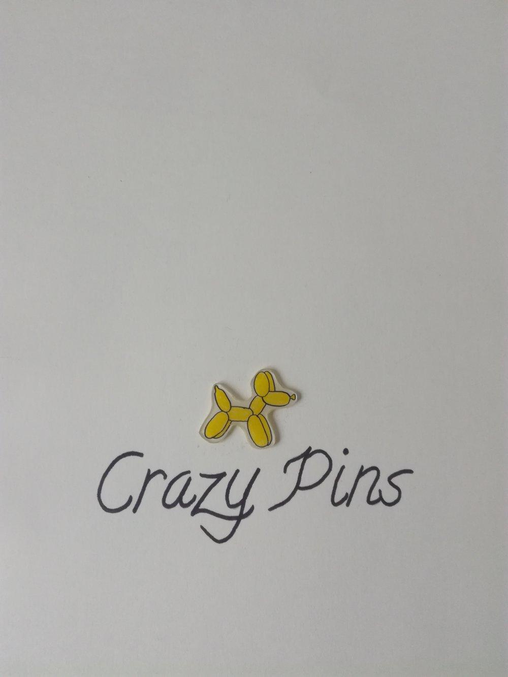 Pin's ballon chien jaune