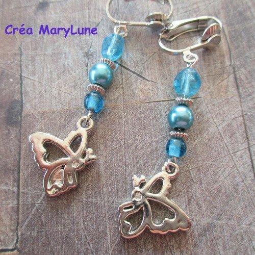 Boucles d'oreilles clips pour oreilles non percées papillon bleu