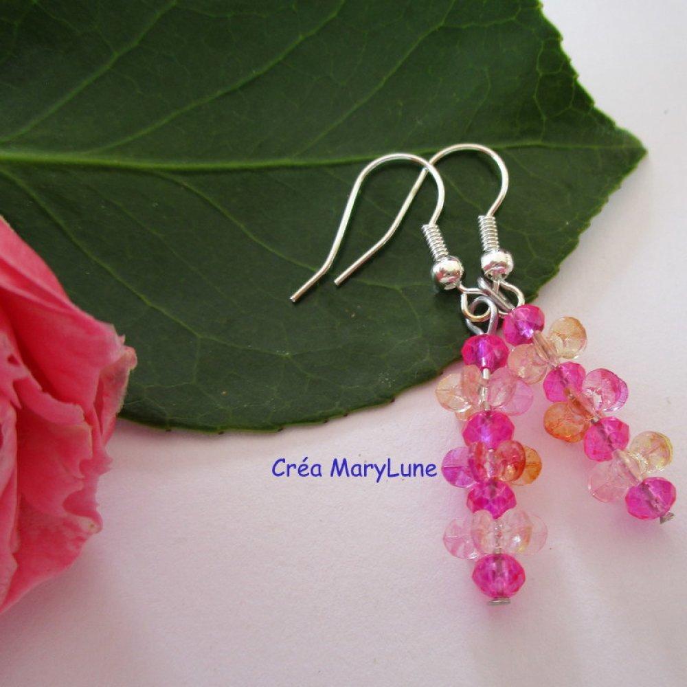 Boucles d'oreilles pour oreilles percées ailettes roses/orangé. Crochets en acier chirurgical