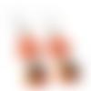 Boucles d'oreilles nœuds en cuir orange, tagua et sequins émaillés noirs sur crochets en acier inoxydables