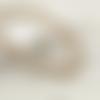 2 fils d'environ 120 perles rondes 5mm 6mm en bois rayé noir
