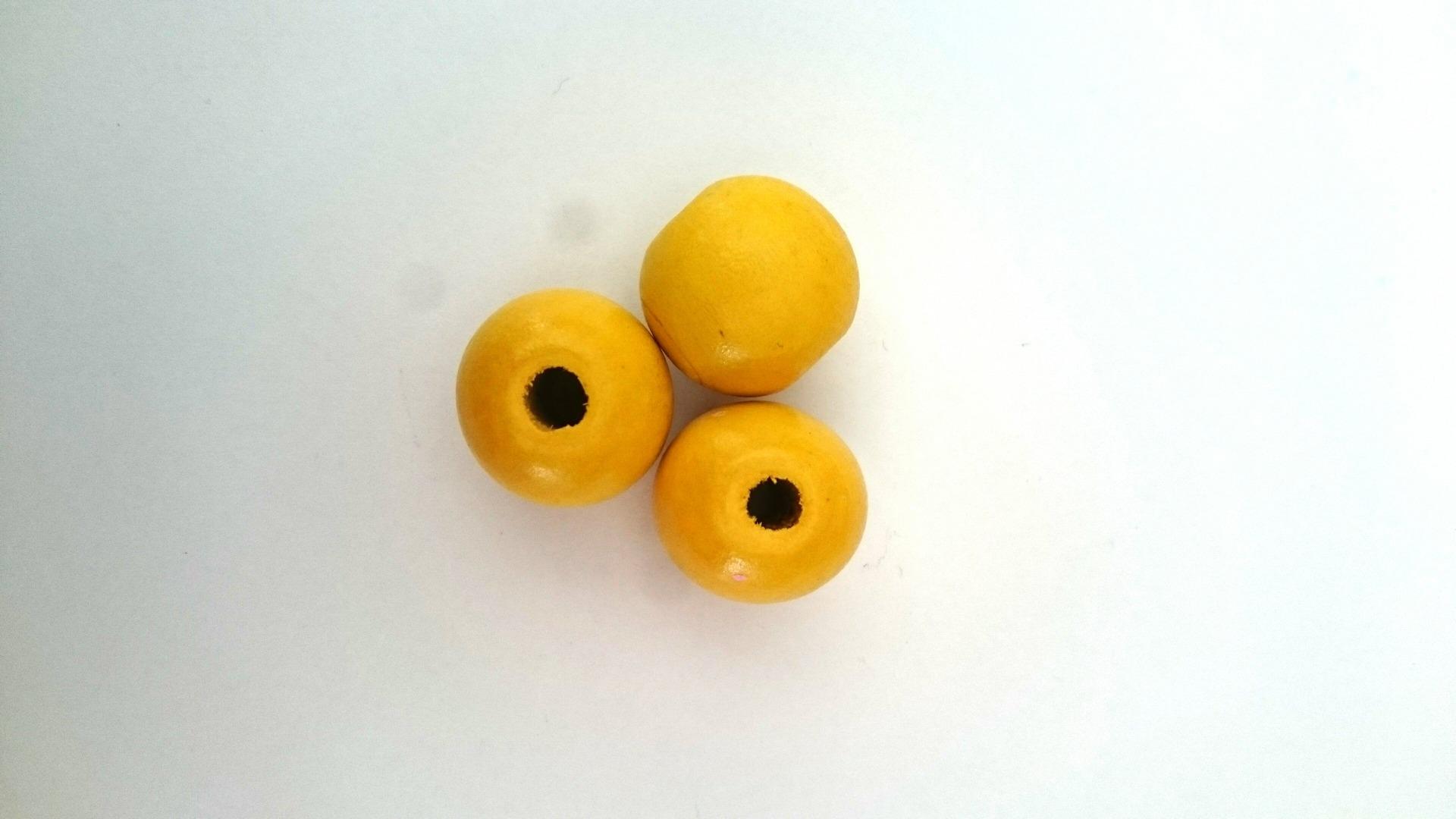 Perle jaune ronde en bois