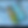 Pendentif en polymère vert et bleu à motifs papillons