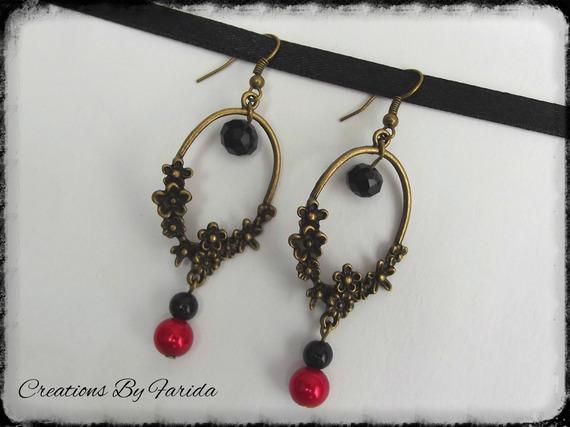 Boucles d'oreilles avec connecteur floral en bronze et perle