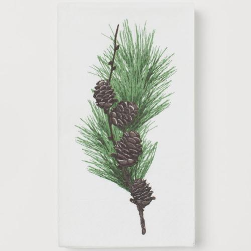 Serviette en papier motif feuilles, branche et pommes de pin sur fond blanc