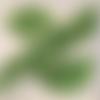 Serviette en papier motif ginkgo biloba verts sur fond blanc
