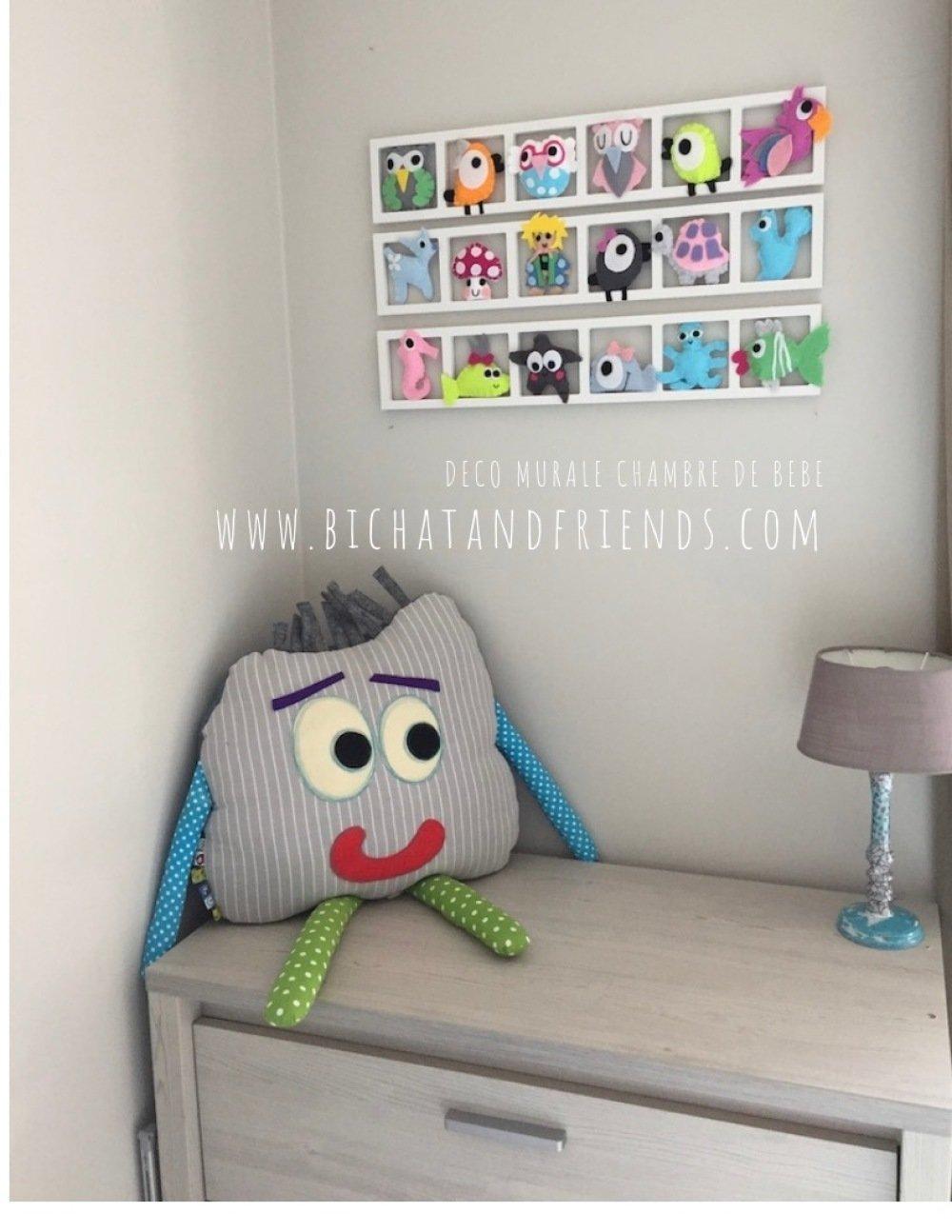 Décoration pour chambre enfant multicolore animaux pastels.