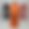 Bombe peinture artistique orange et noire.