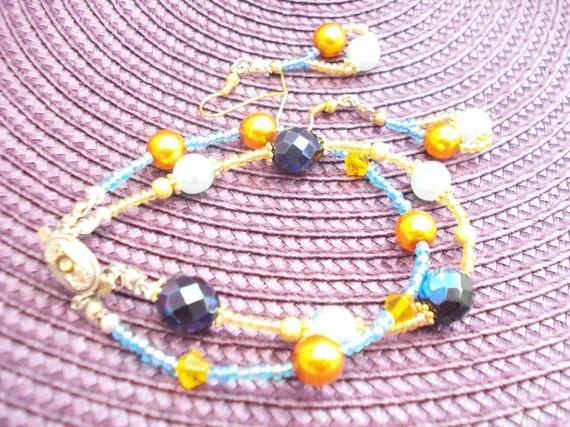 Parure bracelet/boucle d'oreille perles de verre bleu orange doré