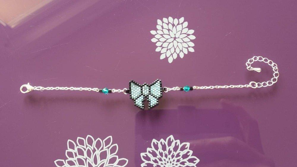 bracelet réglable argenté avec toupies swarovski et tissage de perles de verre