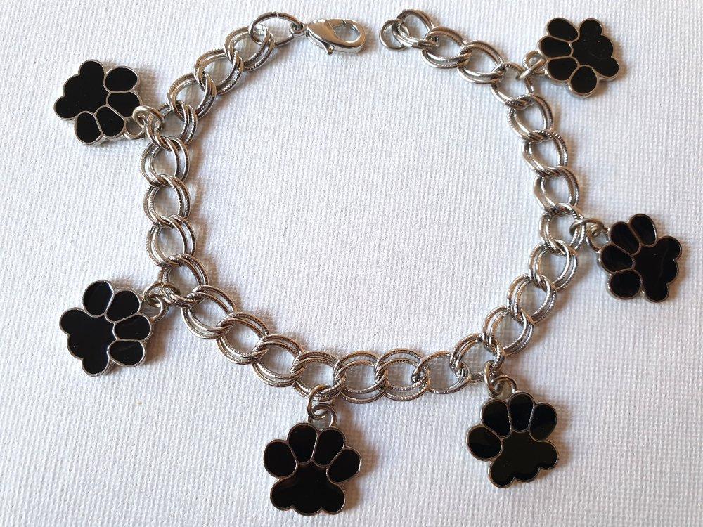 Bracelet gourmette mailles doubles, breloques pattes chien argenté et émail noir