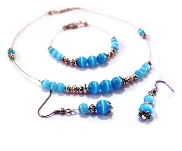 Parure  collier, bracelet,  boucles d'oreilles , duo de bleu et d'argenté,