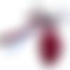 Bijoux de sac agrémenté de sa plume brodé