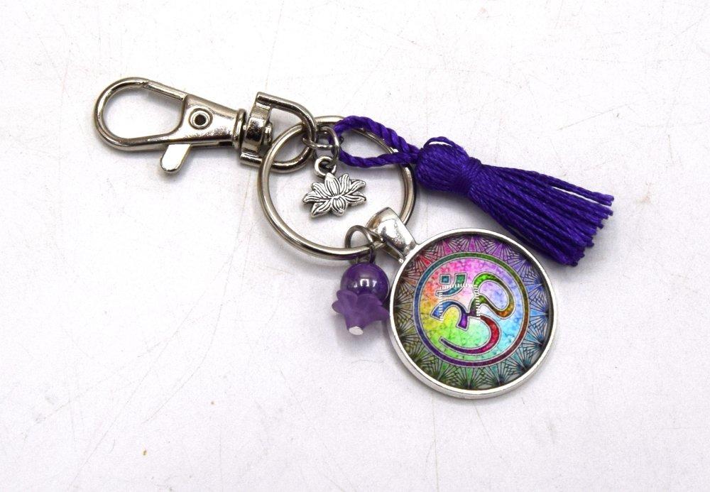 Porte clé Symbole Bouddhiste avec pendentif symbole bouddhiste violet, décoration sac à main, bijoux cabochon pompon.
