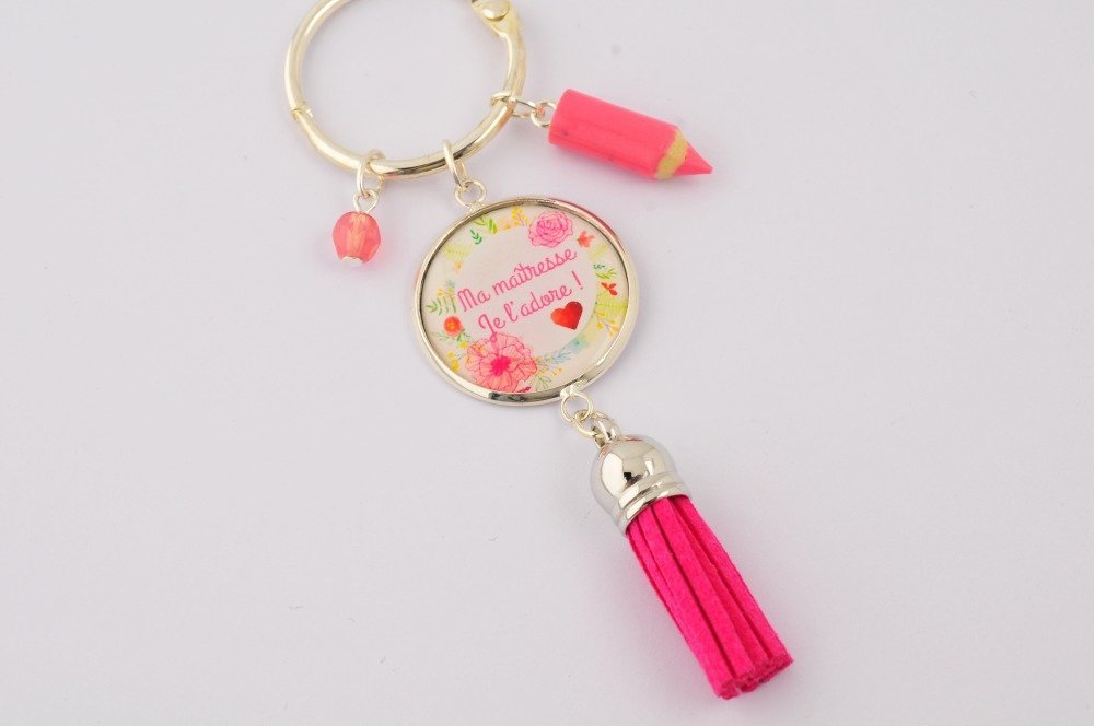 "Porte-clef ""Ma maîtresse, je l'adore"" avec pompon, perle et breloque."