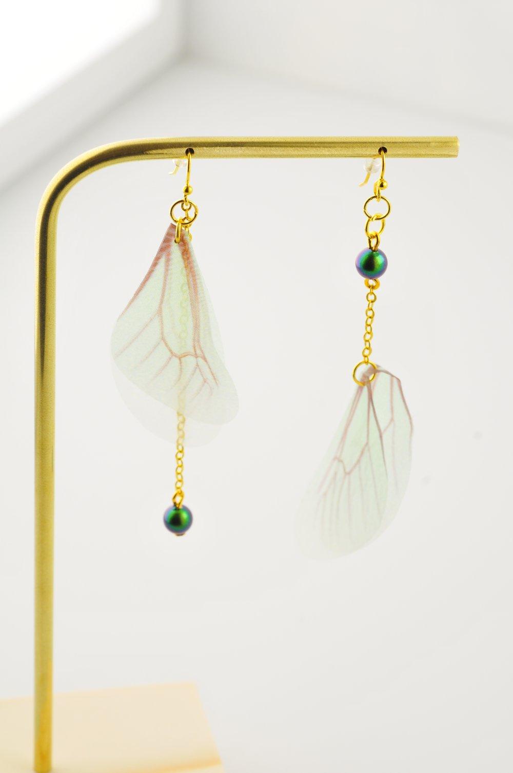 Boucles d'oreilles, perles et ailes en organza