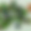 20 perles tubes 10mm verre vert facette métallisé irisé