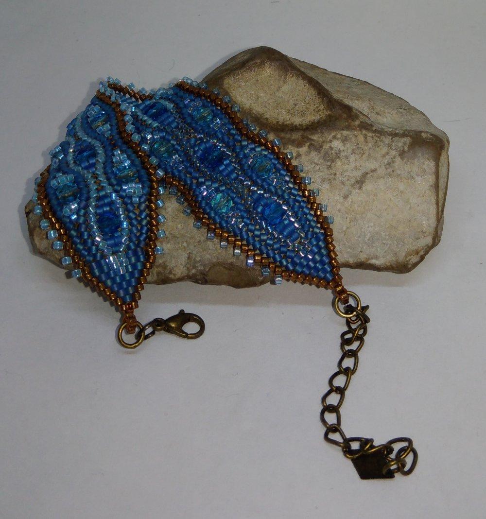 Bracelet tissé à l'aiguille turquoise et bronze