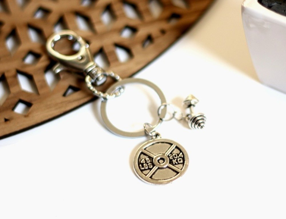 Porte clés pour lui breloque haltères métal argenté