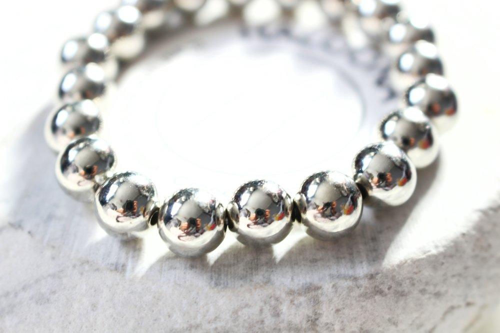 Bracelet - perles en métal argenté