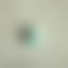 Cabochon en résine en forme de petit ourson coloris bleu