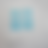 Lot de 4 perles  carrées multi-faces coloris turquoise translucide
