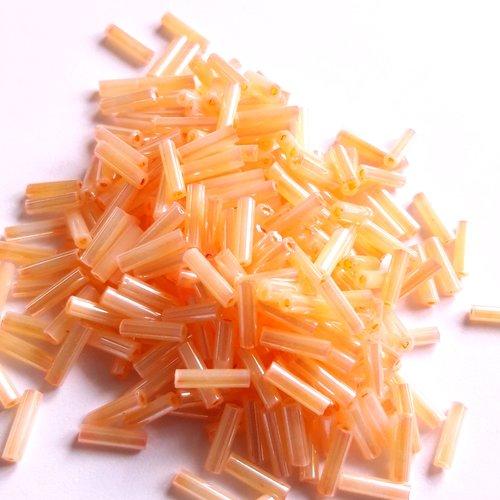 Perles rocaille orange tubes 6 mm - 10 grs t31