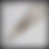 Dragonne en cuir tressé, 21 cm de long. couleur marron avec finitions couleur argent