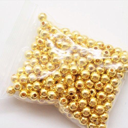 25 perles 12 mm rondes acryliques dorées