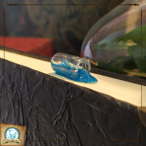 Marque-page effet potion renversée bleue