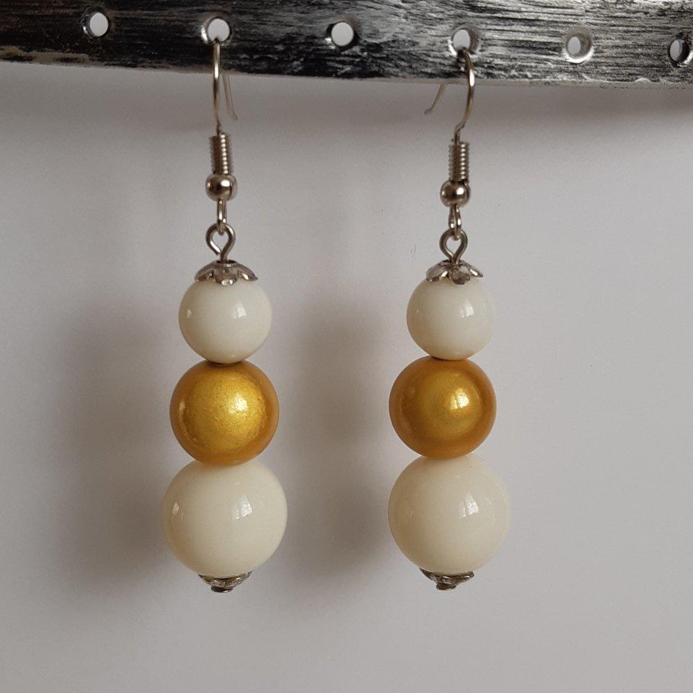 Boucles d'oreilles magique blanc et doré