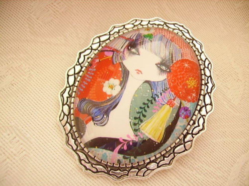 Bijou fantaisie,broche ovale,cabochon verre,motif jeune fille moderne,multicolore,métal argent vieilli