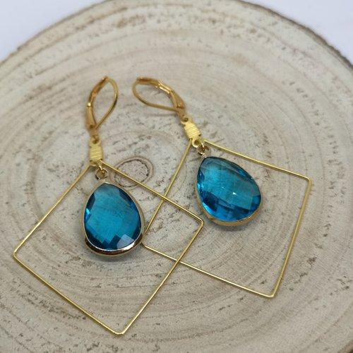 Boucles d'oreille losange acier doré et goutte en cristal bleu