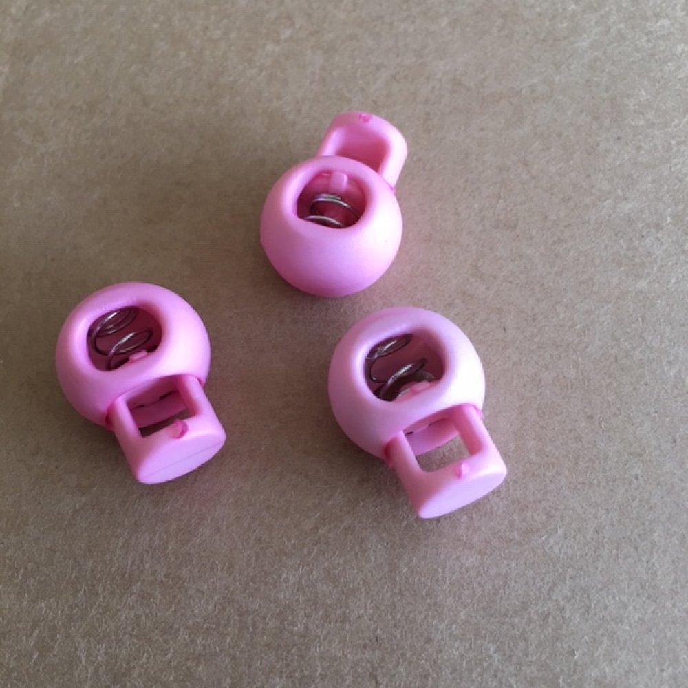 Serre-cordon, en forme de boule, à ressort, de couleur rose, en polypropylène, vente à l'unité