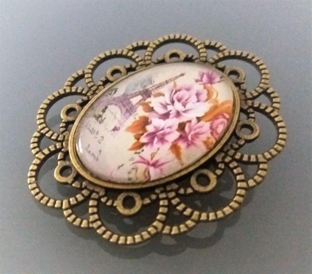 Jolie broche coloris bronze cabochon ovale motif fleurs roses
