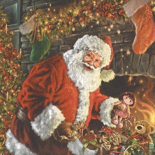 Serviette papier le père noel distribution de cadeau devant la cheminée