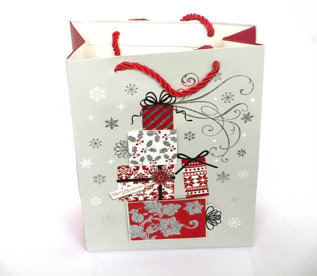 1 Pochette, Sac cadeau Noël  gris  motifs cadeaux 18x24x8 cm