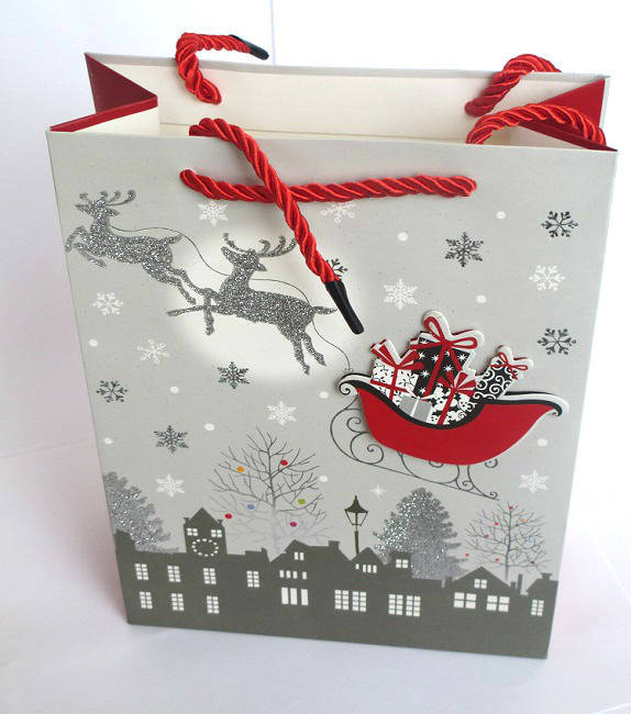 1 Pochette, Sac cadeau Noël  gris  motifs traîneau  18x24x8 cm