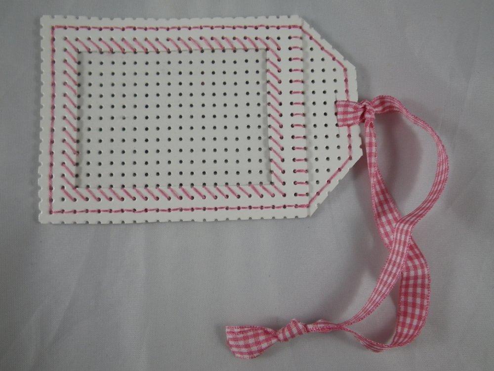 Etiquette blanche et rose en vinyle perforé pour bagages