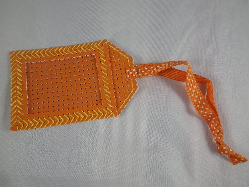 Etiquette orange en vinyle perforé pour bagages
