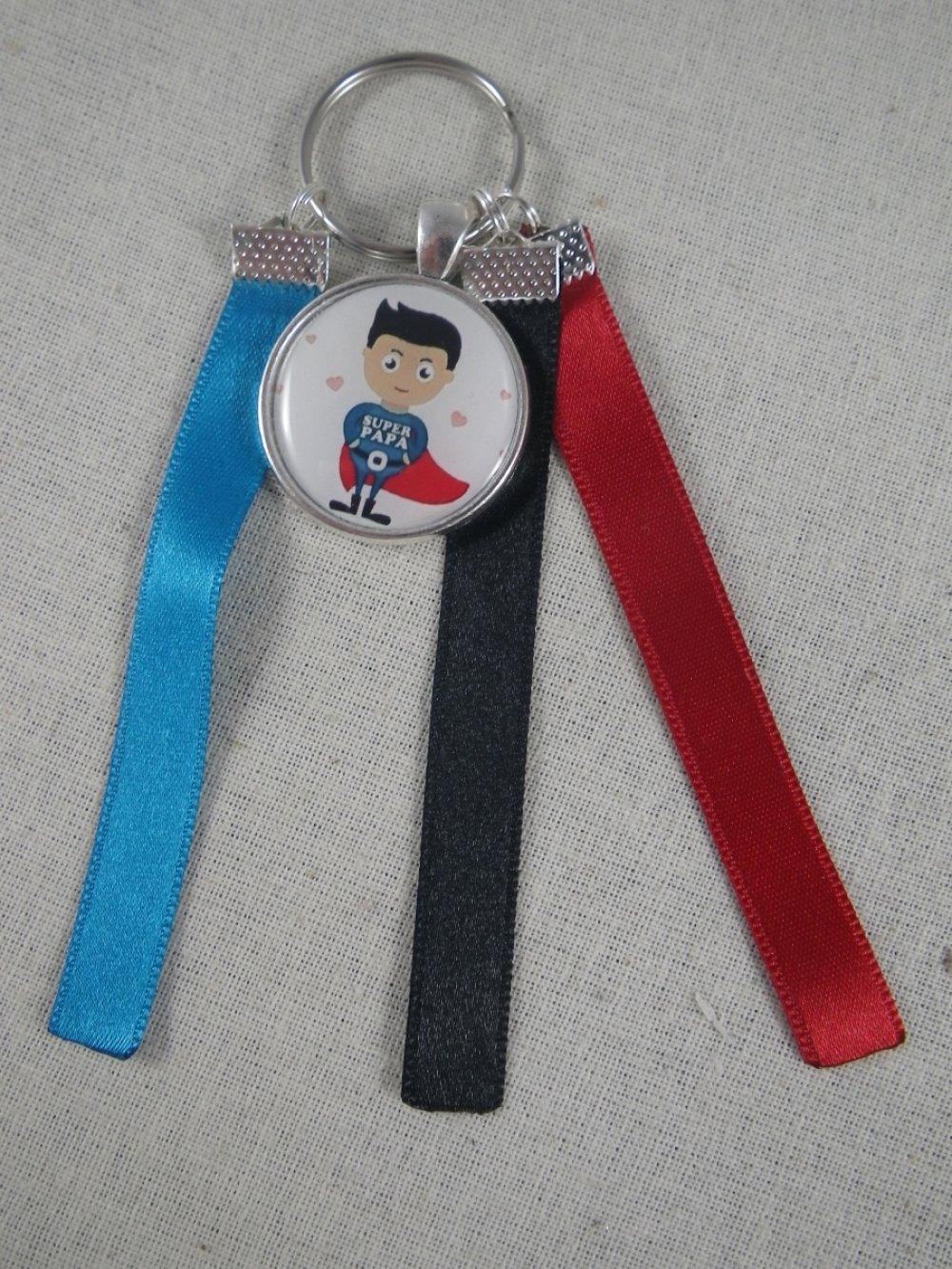 """Porte clés rouge et bleu """"Super papa"""""""