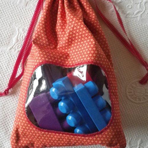 Pochette / sac hublot orange et rouge