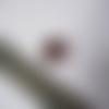 Une perle en verre ovale, orange foncée 13x10 mm