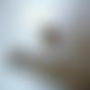 Une boule couleur argenté 13x12 mm