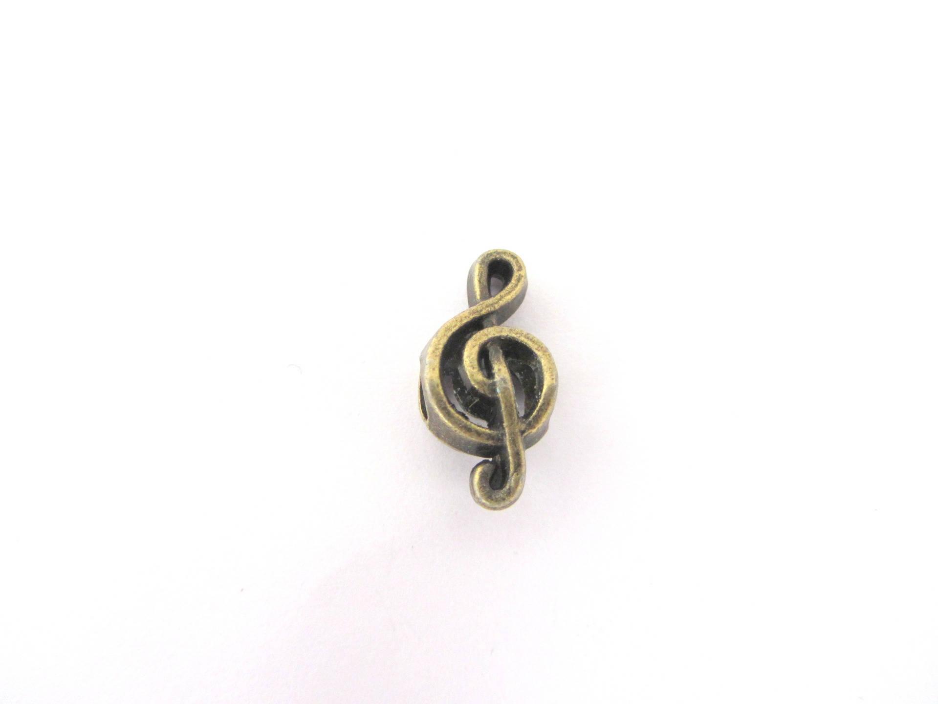Une perle passante, forme clé de sol, bronze, bracelet cuir